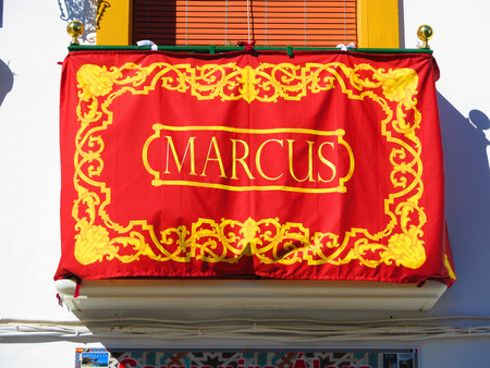 processions: Alora, Spain 25 March 2016: Balcony decorated with name of Apstle as part of Easter processions. Editorial