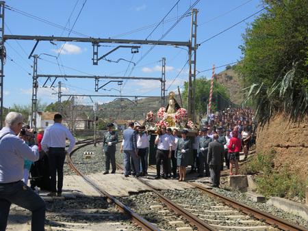 procession: Alora, Spain 24 April 2016: Religious procession crossing railway line near Alora, Andalucia