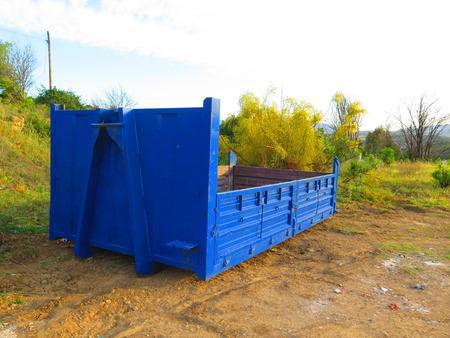 wasteland: Empty blue builders skips on wasteland near Alora Andalusia