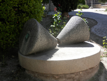 cone shaped: Two Old Cone shaped olive oil millstone