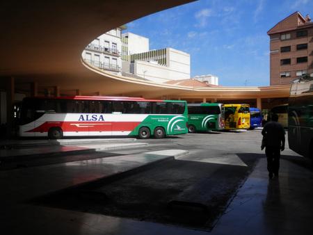 busses: Jaen, Spain 3 june 2016: Busses waiting under curved roof in Jaen bustation, Spain