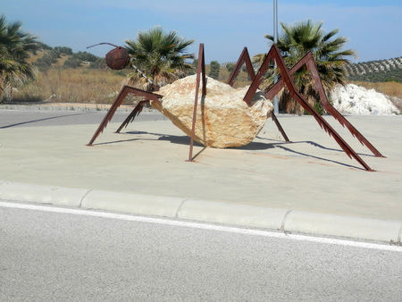 Large Steel and concrete insect on roundabout near Jaen, Andalusia