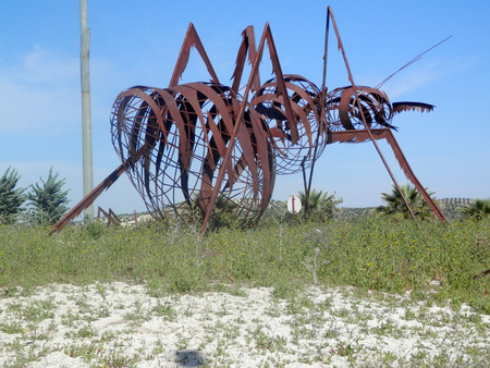 roundabout: Large Steel and concrete insect on roundabout near Jaen, Andalusia Stock Photo