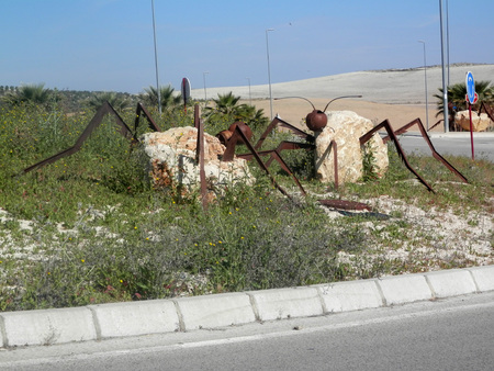 roundabout: Large Steel and concrete insects on roundabout near Jaen, Andalusia Stock Photo