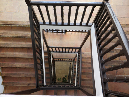 bannister: Wooden stairs, stairwell and railing in Jaen Arabic Bath museum Stock Photo