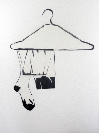 coathanger: Illustration of Coathanger and stockings on hotel room wall in Maastricht, Holland