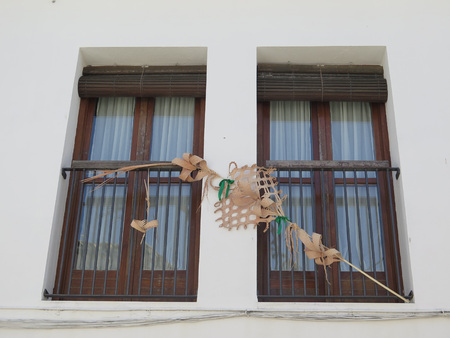 decorative balcony: Decorative palm frond in window in Jewish quarter of Jaen, Andalusia Stock Photo