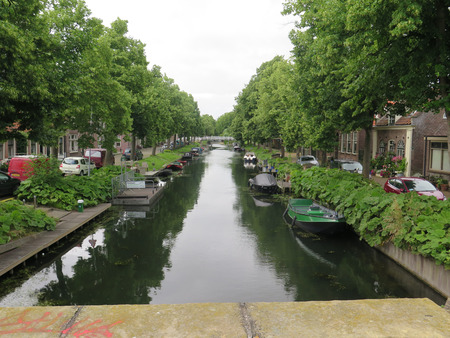 reside: Boats moored on Canal in Dutch village Editorial
