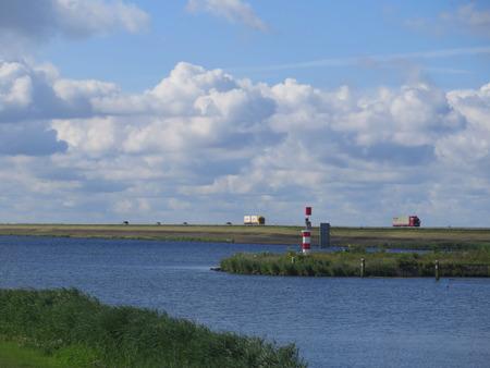 lelystad: Lorries on road on dike between enkhuizen and lelystad in holland