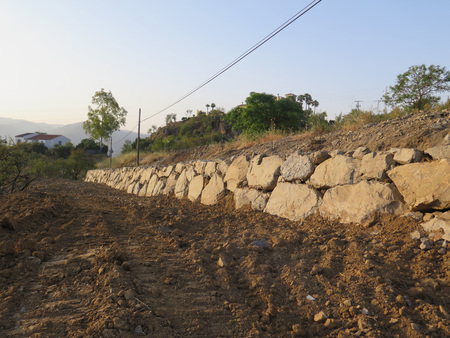 retaining: New long retaining wall for subsided road