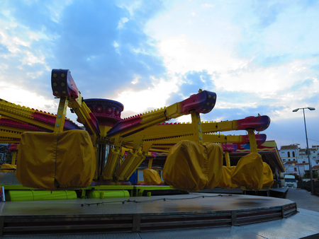 fairground: Alora, Spain - July 31 2016: Closeup of Colorfull Fairground Equipment before opening