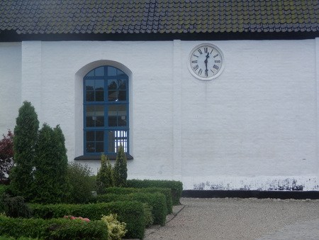 als: Clock on Church Wall on island of Als in Southern Denmark Stock Photo