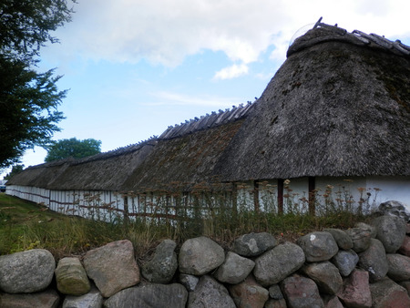 thatched: Thatched stables at church on island of Als in Southern Denmark