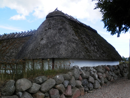 als: Thatched stables at church on island of Als in Southern Denmark