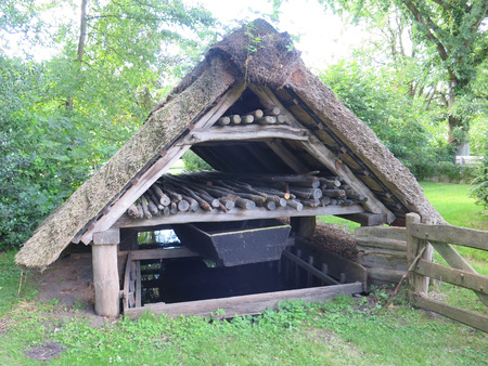 outhouse: Thatched wood store in Bad Zwischenahn in Nortwest Germany Editorial