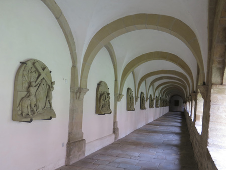 White Cloister Corridor in saint Peters Cathedra, Osnabruck, Germany Stock Photo