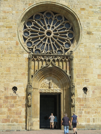 mediaval: Entrance doorway and stained glass window of Osnabruck Saint Peters Cathedral Stock Photo