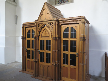 confess: Wooden carved cofessional in Saint Peters cathedral, Osnabruck, Germany