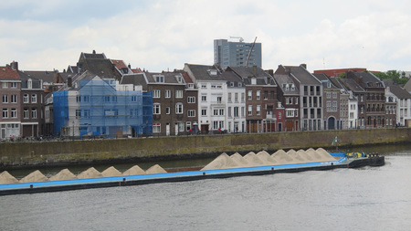maas: Barge carrying sand on River Maas in Maastricht, Holland