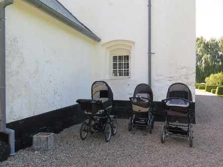 prams: Three Prams parked outside church in Southern Denmark