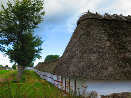 Thatched stables at Egen church in Als, Denmark Stock Photo