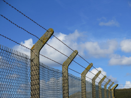 Sturdy concrete and wire fencing at animal farm on Isle of Portland, Dorset, UK Фото со стока