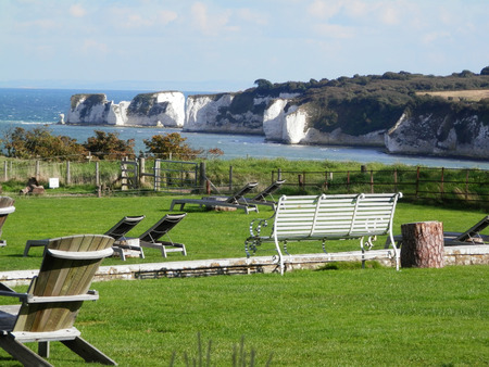 seating area: Publick Picnic area with grass and wooden seats on Dorset coast