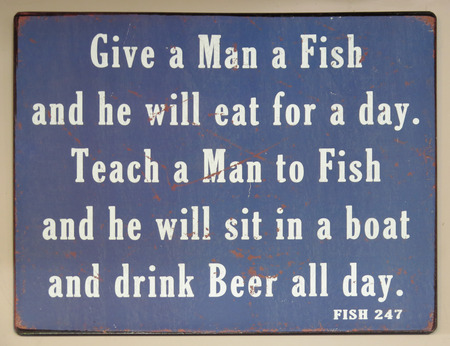 wall mounted: Wall mounted Devon fishing proverb in village pub
