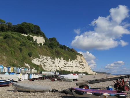 tier: Two tier beach huts, Beer, East Devon, England, UK