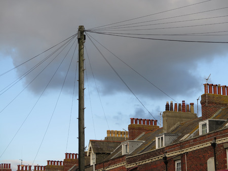 Telegraph Pole and Chimney Stacks against cloudy sky in Weymouth, Dorset, UK Stock Photo