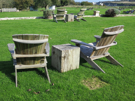 seating area: Public Picnic area with grass and benches on Dorset coast