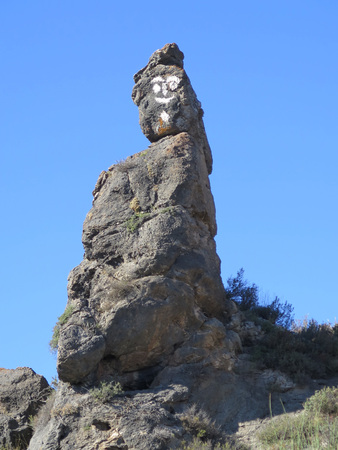 Painted Rock Face on mountain road in Andalusia, Spain Editorial