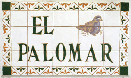 Tiled Spanish Village Street Sign on wall