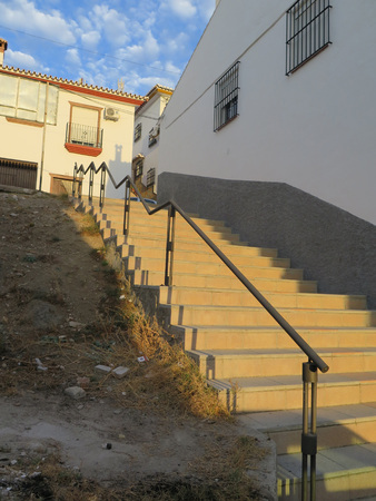 steep: Ornate railing and steep steps in Alora Andalusia Stock Photo
