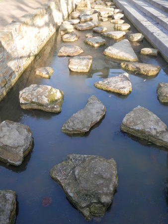 stepping on: Stepping Stones in Canal, Valkenburg, Limburg, The Netherlands, Europe.