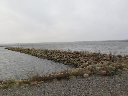 breakwater: Low breakwater on Flensburg Fjord protecting Holiday Marina