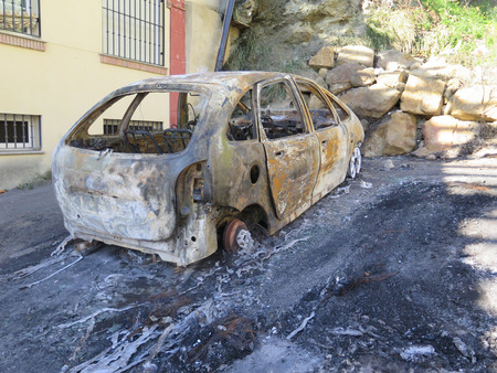 burned out: Leftover of Burned out car in residential area of Alora, Andalusia