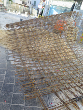 Alora, Spain - March 25, 2017: Wire Mesh and pile of sand waiting to be laid down as base for new road surface in village street