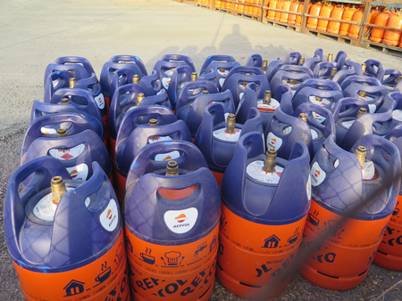 preassure: Alora, Spain - July 18. 2017: Butane gas bottles at depot in Andalusian countryside