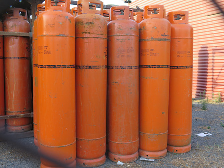 preassure: Alora, Spain - July 18. 2017: Propane gas bottles at depot in Andalusian countryside