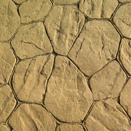 Irregular pattern in yellow cement pavement in Andalusian village Stock Photo