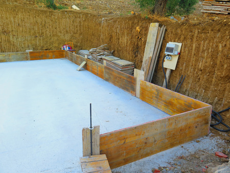 Concrete floor slab, shuttering and temporary electricity supply at dug out space for new house in Andalusian Village