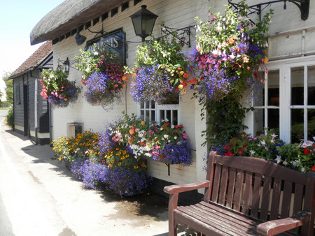 Aldworth, England - August 5, 2017: Flowers outside 17th century pub in Hampshire, England