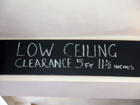 Chalk warning on black beam in English public house
