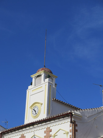 eec: Alora town hall clock and belfry on bright summers day