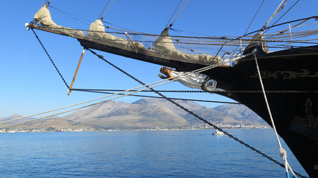 Gaeta Lazio Italy - beautiful view of the blue sea and the hills behind tall ship bowsprit