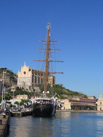 Gaeta, Italy - beautiful view of three masted tall ship below blue sky and church