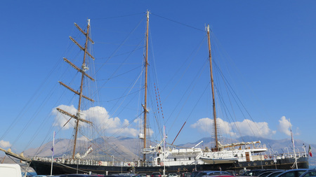 Gaeta, Italy - beautiful view of the blue sky and the hills behind three masted tall ship