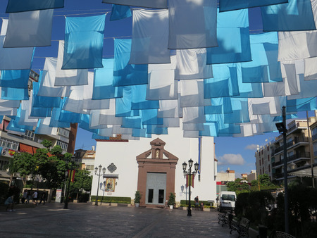 Fuengirola, Spain - October 4, 2017: Blue and white flags in Fuengirola church square, Andalusia Editorial