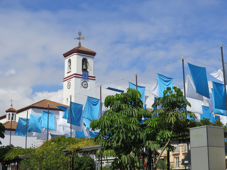 Blue and white flags in Fuengirola church square, Andalusia Stock Photo - 90010976